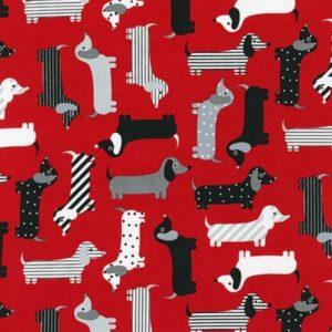 Tessuto in cotone americano - fantasia animali cani bassotto fondo rosso - Filomania